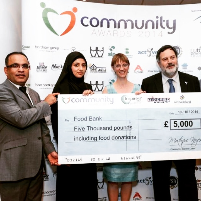 Ashuk Ahmed Presenting A Cheque To Luton Food Bank Diverse Fm